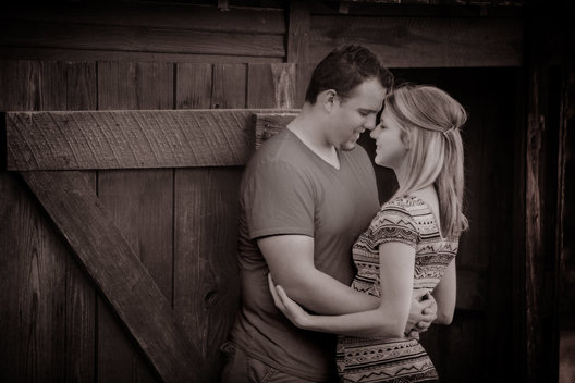 Engagement Portrait taken in Dallas, Texas, in a barn setting.