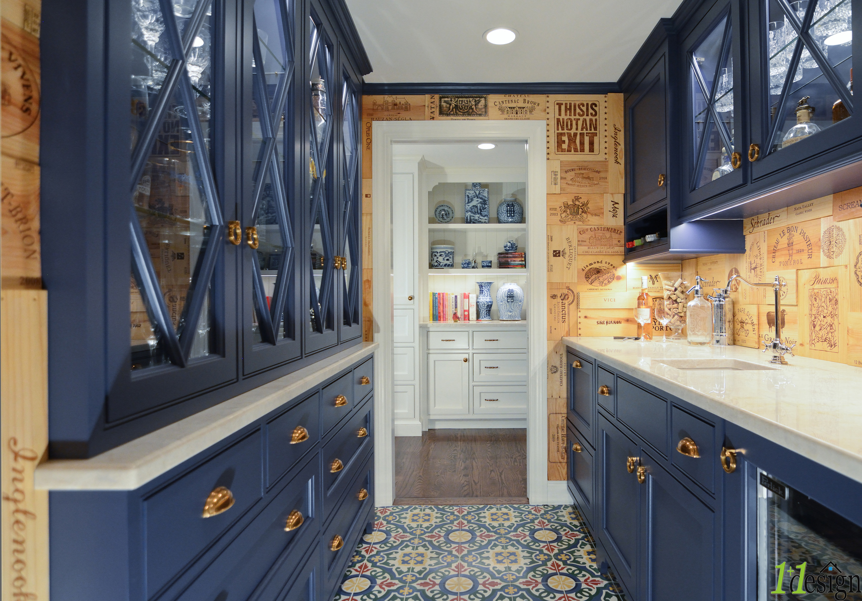 A new butlers pantry with wet bar and blue cabinets.