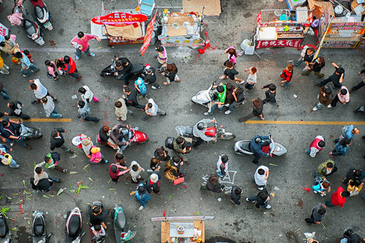Taiwan, Yenshui, Tainan.  Aerial view of crowd walking in street at Yenshui Fongpao Firework Festival