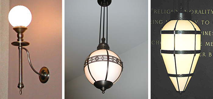 Recreation of original solid brass sconces and opal glass pendants from archival documentation