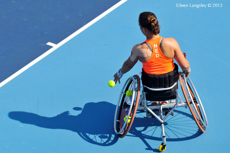 Marjolein Buis (Netherlands) bounces th ball before serving during her first round singles match in the women's wheelchair Tennis competition at the 2012 London Paralympic Games.