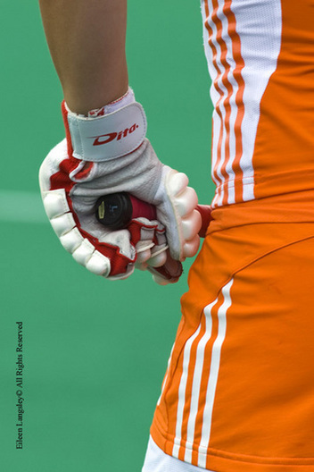 A cropped generic image of the hand, glove and stick of a Dutch player as she waits to go on the pitch for the final at the 2010 Women's World Cup Hockey Tournament in Nottingham.
