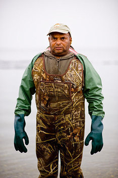 "Herman ""Chuck"" Quinn, an employee of the Shinnecock  Shellfish Hatcheries and Environmental Center,  at Cuffee's Beach on the Shinnecock Indian Reservation in Southampton, NY"