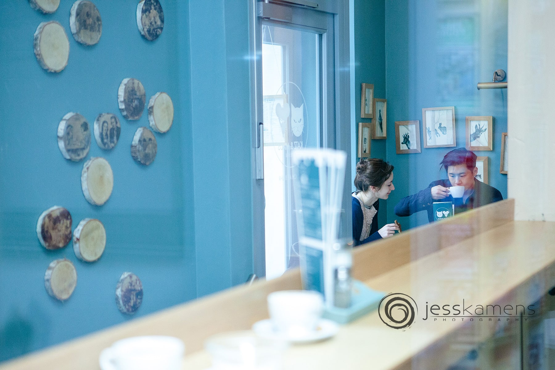 business branding image shows the inside of a cafe with 2 people drinking coffee