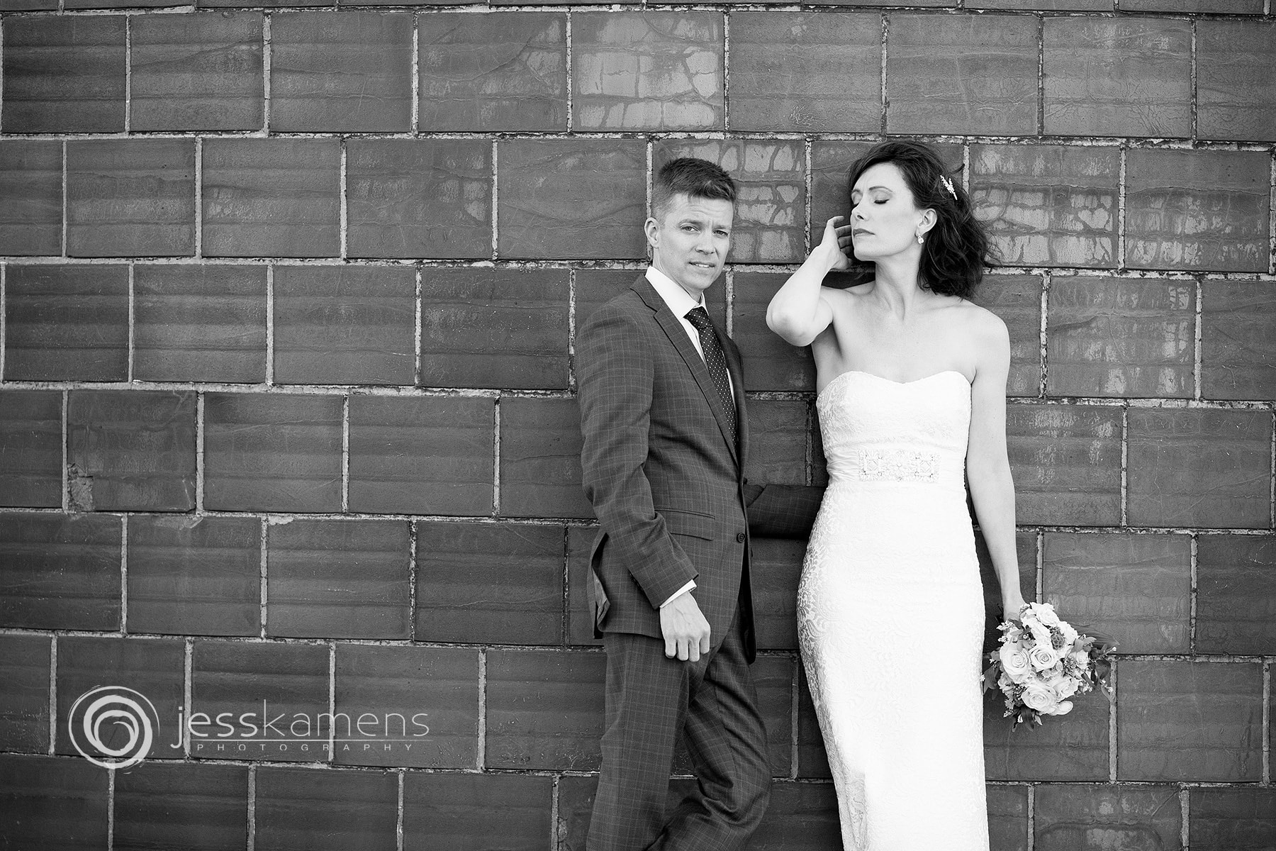 newlyweds pose for their portrait session on their wedding day