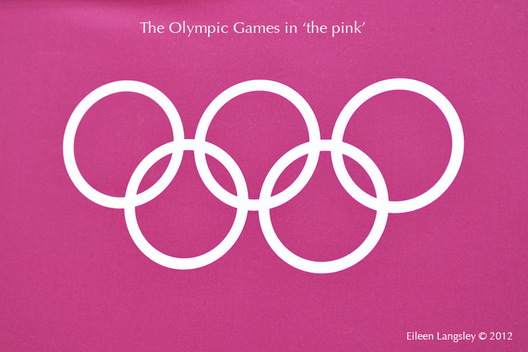 The Olympic Rings on a magenta background at the London 2012 Olympic Games.