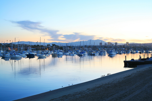 The sun rises over Newport Harbor in Newport Beach, Calif.