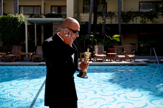 Adam Elliot takes a call by the pool at The Hollywood Roosevelt Hotel the morning after his win for Best Animated Short Film.