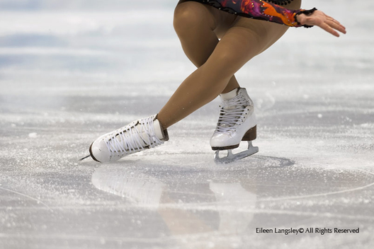 A cropped action generic image of a female skater's feet during a sit spin with reflections in the ice at the 2010 Winter Olympic Games in Vancouver.