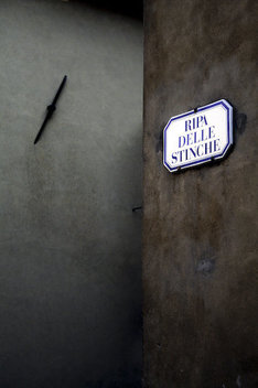 A street sign on a wall in Pistoia, Italy