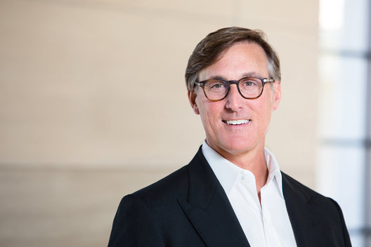 Commercial portrait of business man wearing glasses by commercial photographer Nancy Rothstein