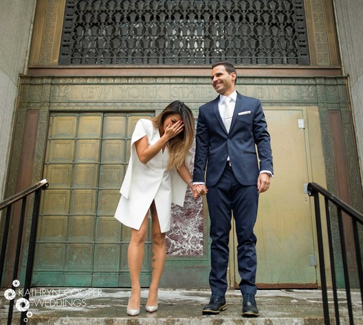 New York City Hall elopement photographer couple just married laughing