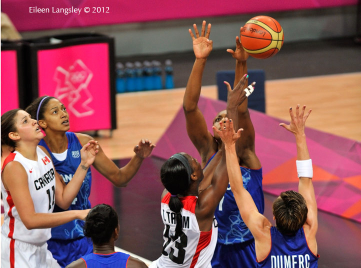 French players reach for the ball during their Basketball match against Canada at the 2012 London Olympic Games.