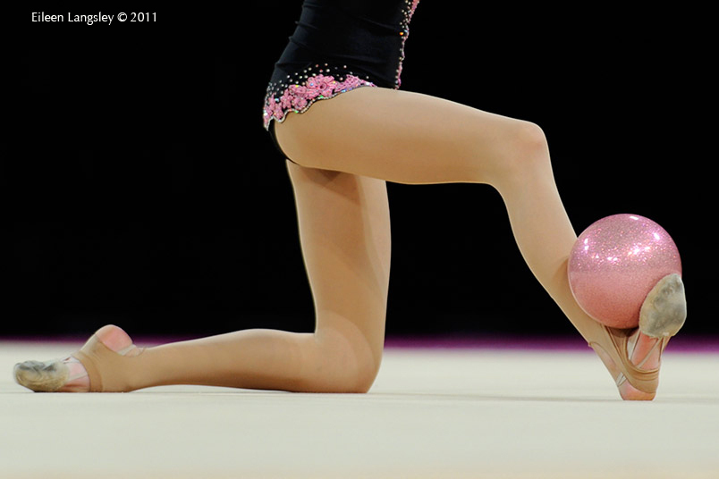 A cropped generic image of a gymnast competing with Ball at the World Rhythmic Gymnastics Championships in Montpellier.