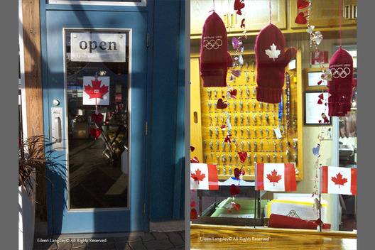 A double image of a shop door (left) and the window of a hotel reception area (right) both with celebration decorations for the 2010 Winter Olympic Games in Vancouver.