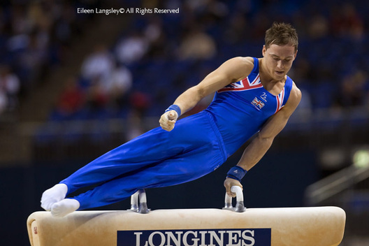 An action image of Daniel Keatings (Great Britain) competing on Pommel Horse at 2009 London World Artistic Gymnastics Championships at the 02 arena.