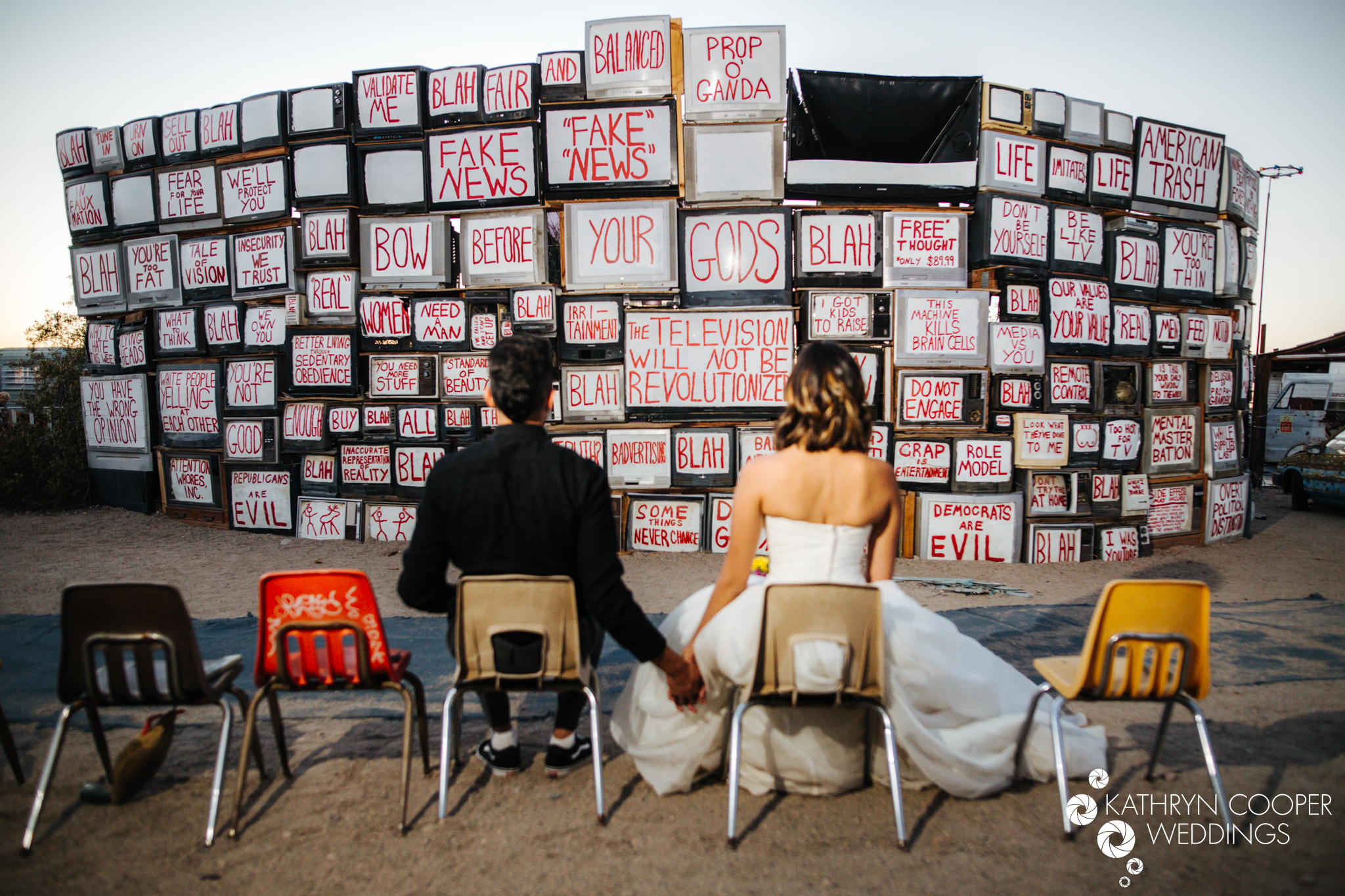 Different types of wedding photos signs political wedding with Latino couple seated in California desert for adventure shoot