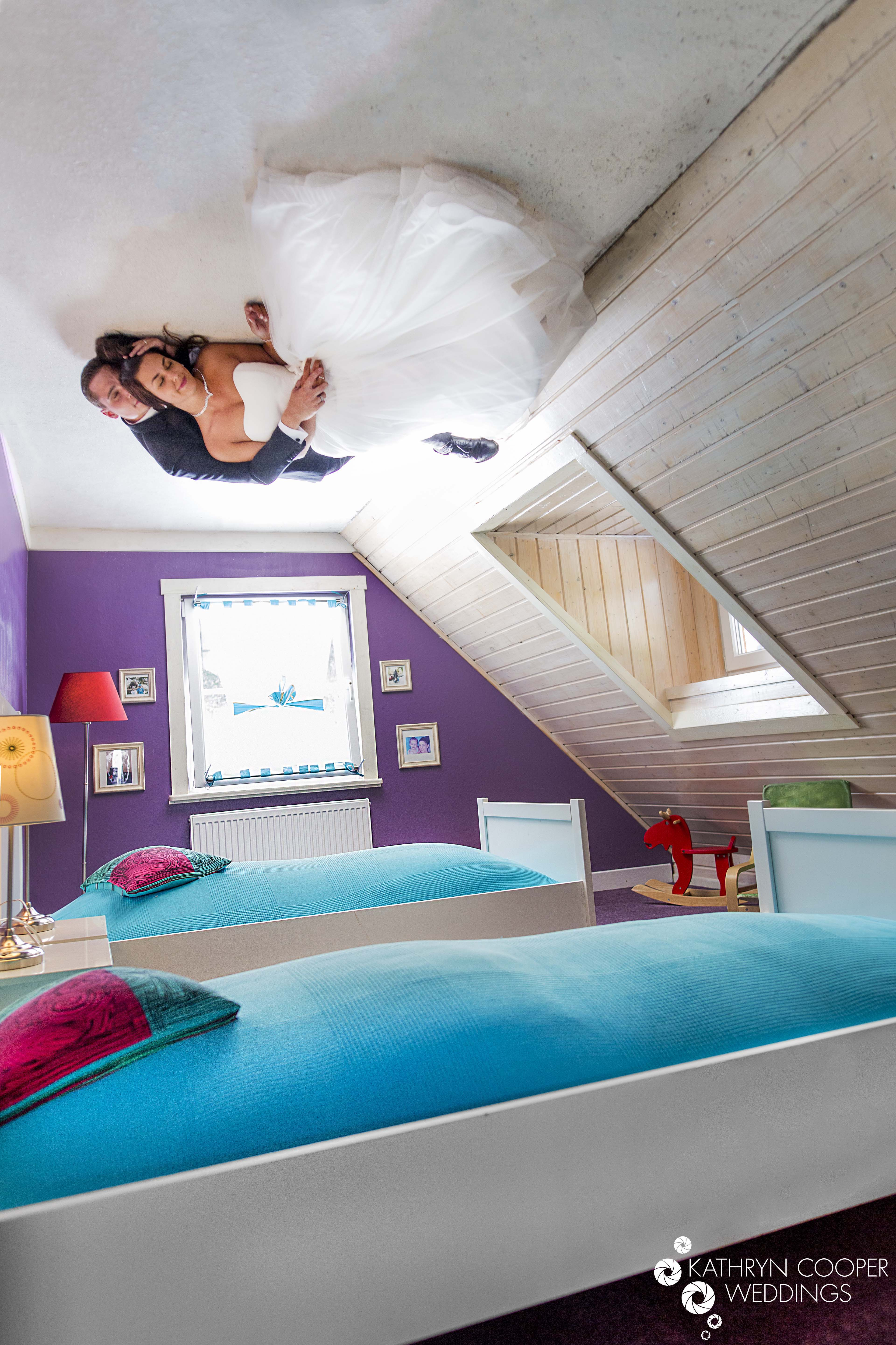 Unique wedding photo of couple upside down on ceiling, couple asleep in Austria at museum