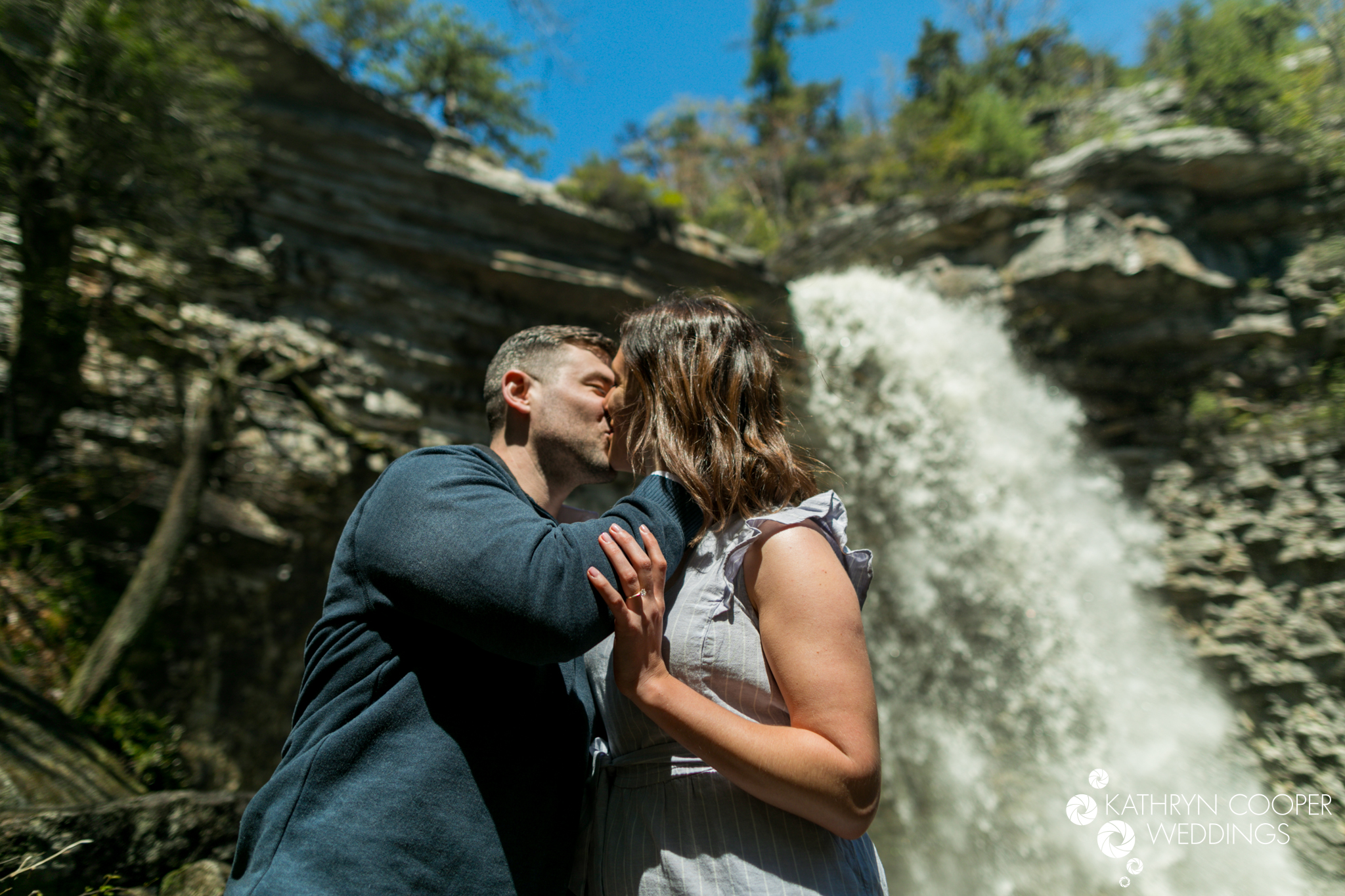 New Paltz waterfall in Minnewaska with Queens couple engagement photos under falls