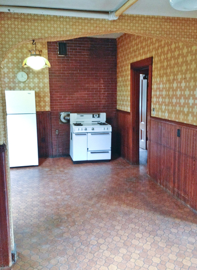 The existing kitchen was in it's original state with no cabinetry, built ins or counter tops.