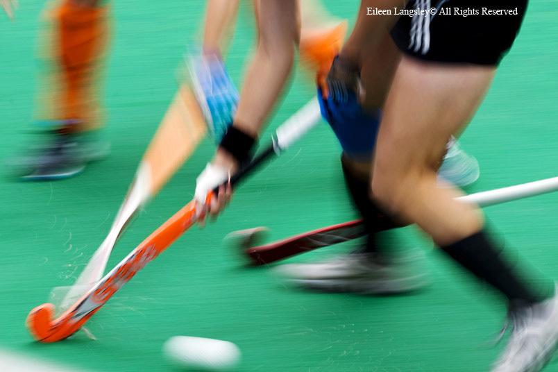 A blurred motion generic image of a Dutch and German players in a tackle during their match at the 2010 Women's World Cup Hockey Tournament in Nottingham.