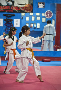 Children in Guatemala City take karate class.