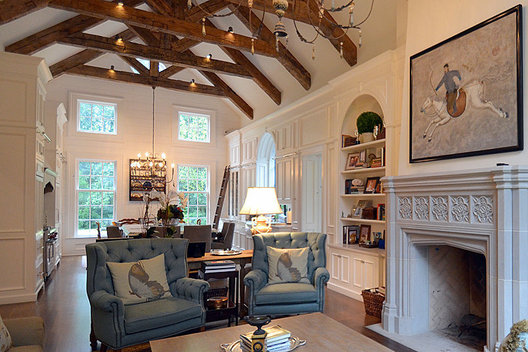 Matching Built-Ins flanking fireplace lead the eye from the keeping room into the kitchen.