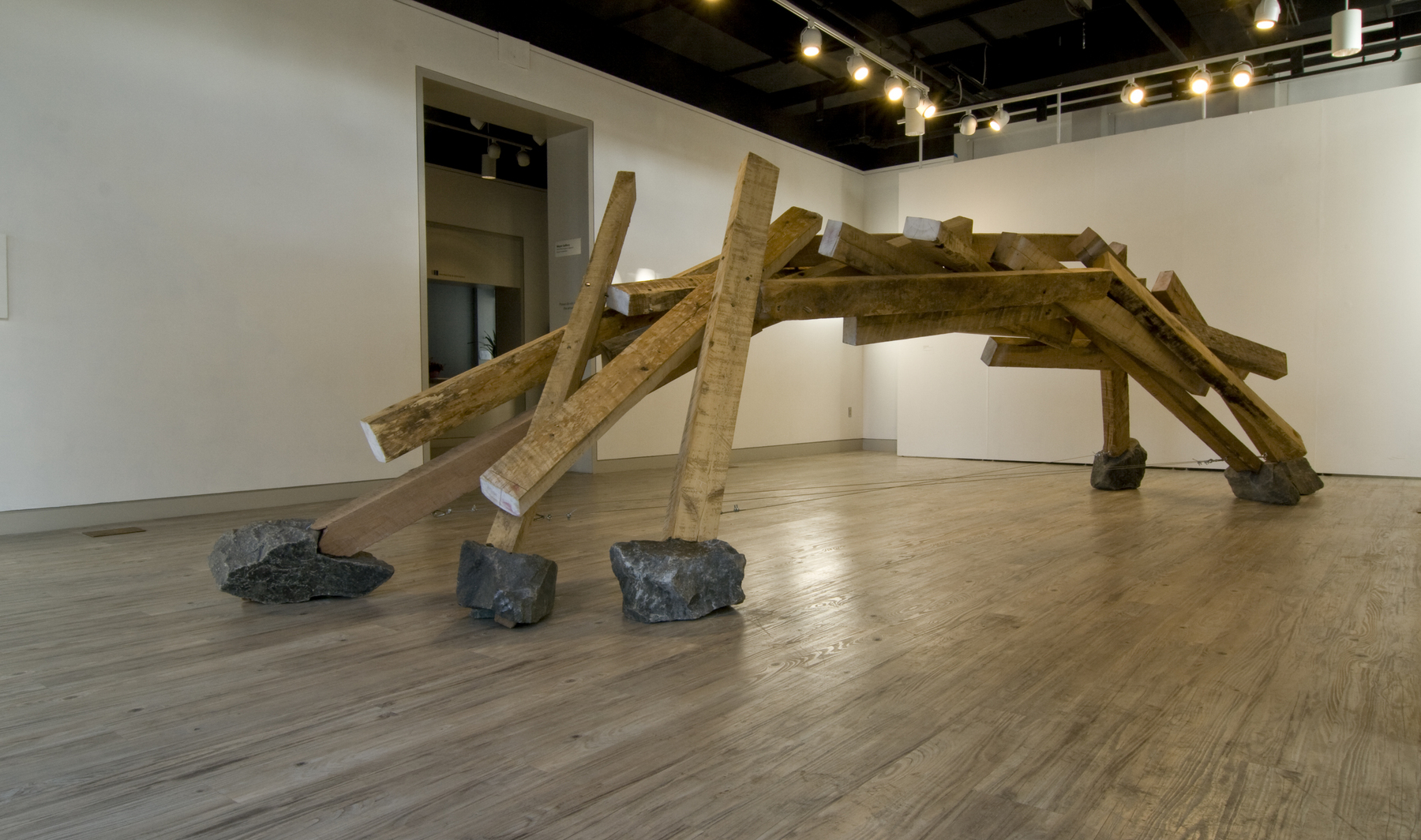"Built of Rough-hewn red oak and poplar beams, local-sourced flagstone, ½"" steel pins, aircraft cable & tensioning turnbuckles, ""Midway"" is the most brute of materials made elegant. It is visual poetry with a nod to traditional Japanese carpentry.
