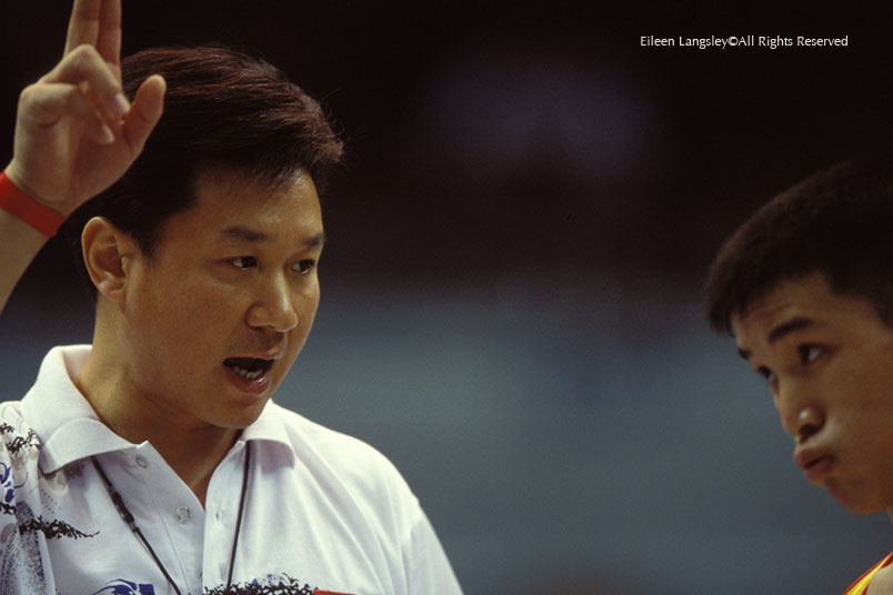 Huang Yubin the National Men's coach of China advises his gymnast Lu Yufu on the finer points of technique.