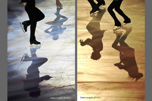 A generic image of the shadows of ice dancers performing in the Exhibition Gala at the 2012 ISU Grand Prix Trophy Eric Bompard at the Palais Omnisports Bercy
