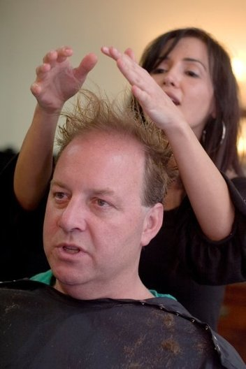 "David Elles gets advice from barber Lilian Cohen on how to style his new haircut. Cohen is the owner of Legacy Barber Shoppe in Huntington Beach, an ""old-fashioned barber shop with a modern twist."""