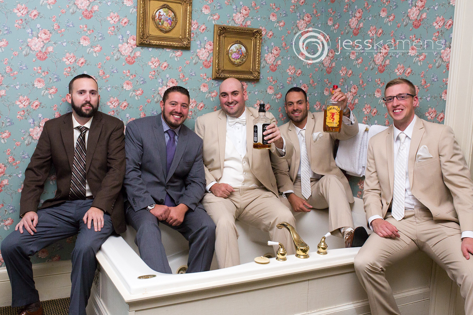 groomsmen sit in a bathtub