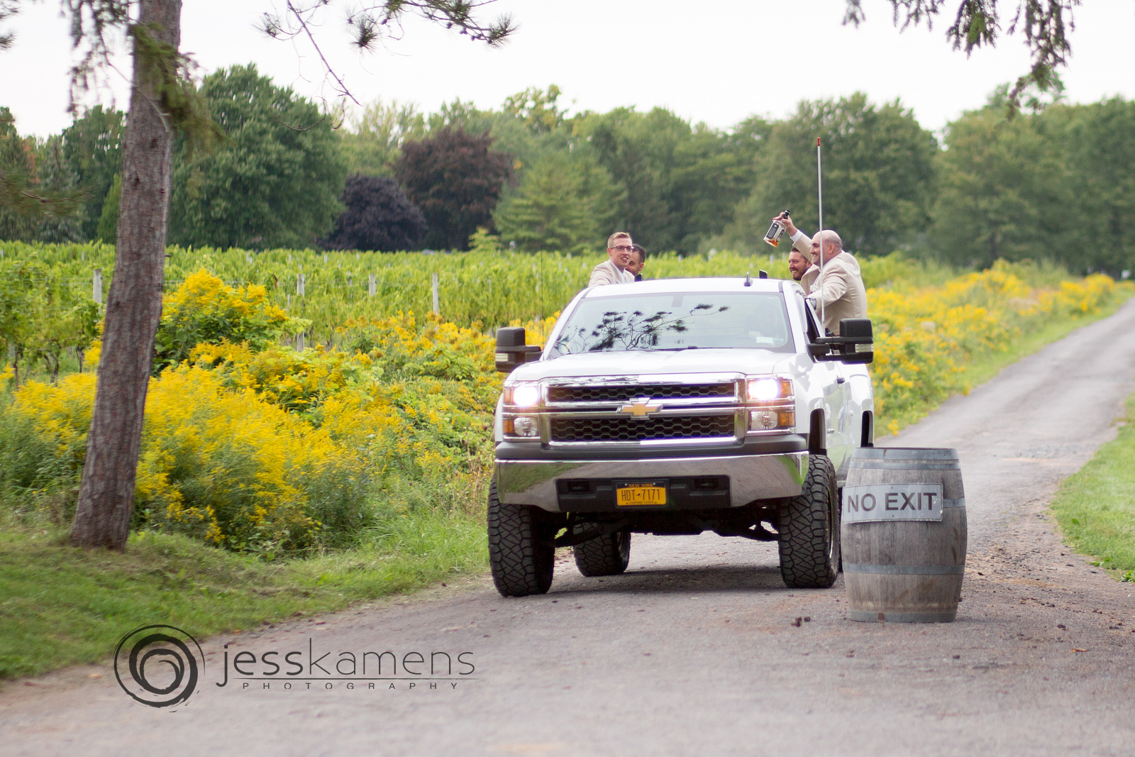 the groomsmen arrive on a truck