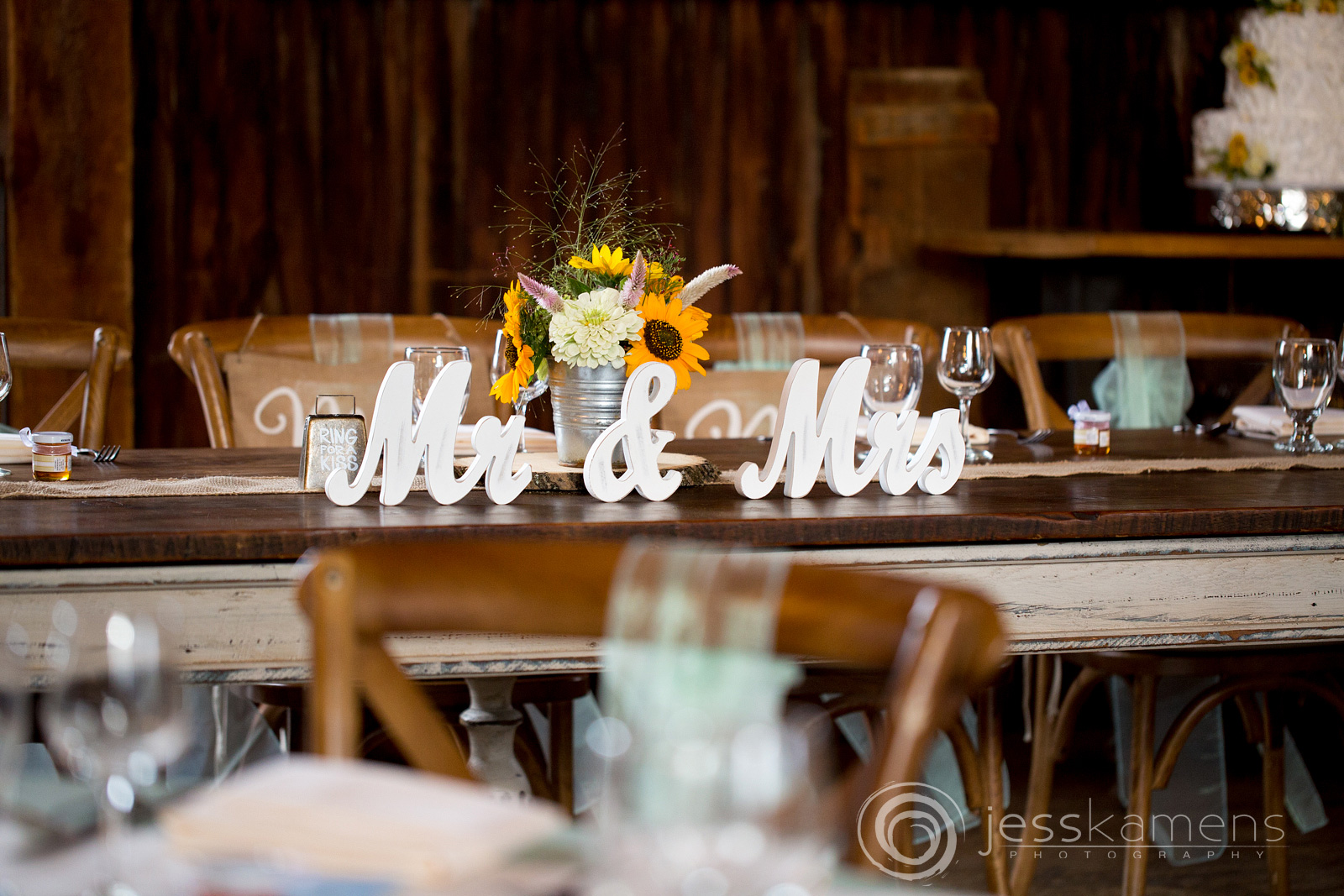 the head table Mr and Mrs signs