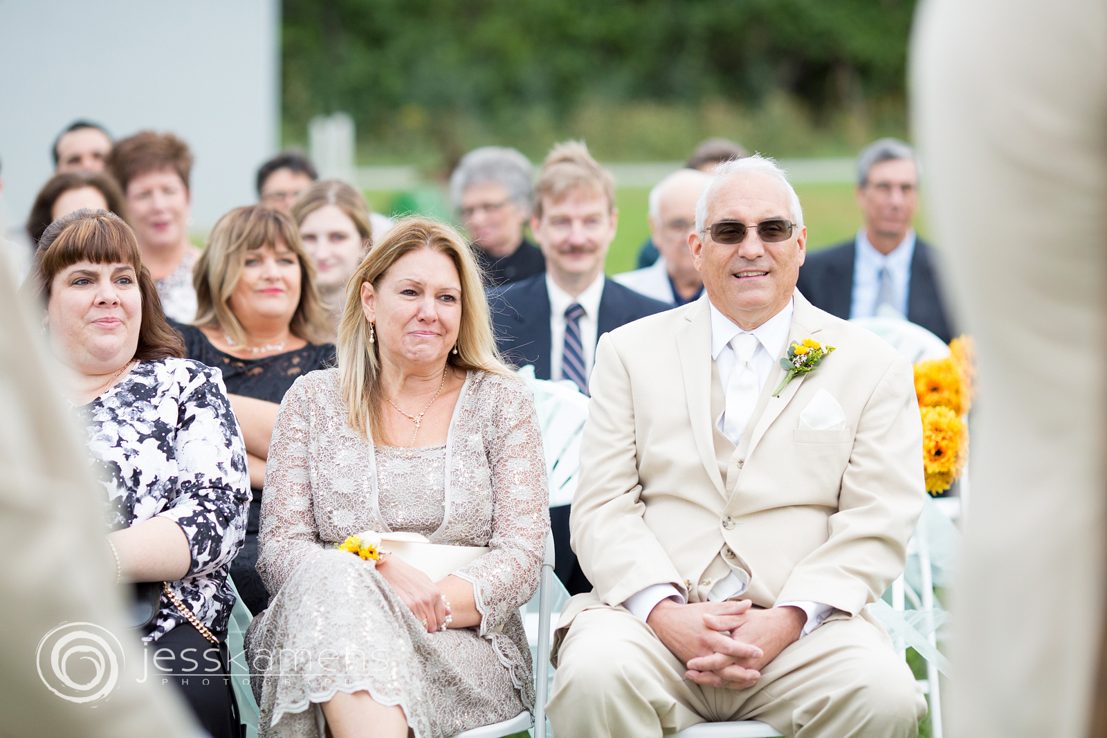 parents of the newlyweds watch the wedding