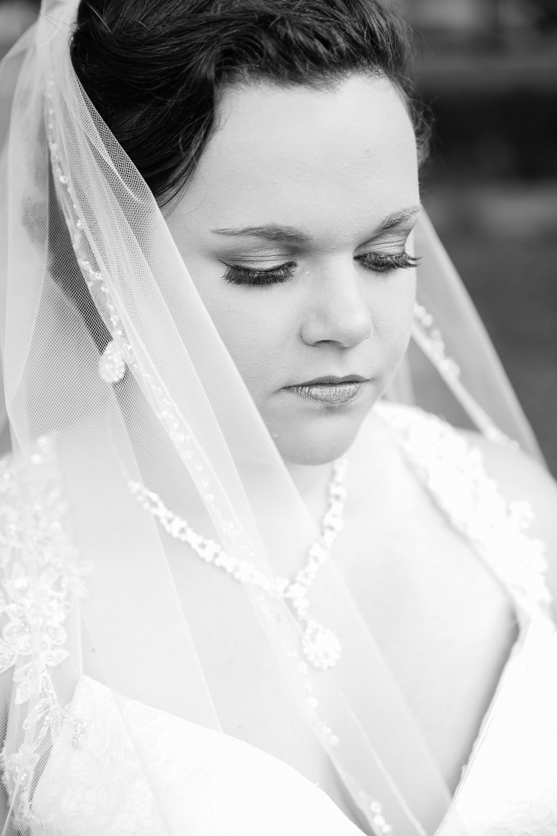 bride with veil across face