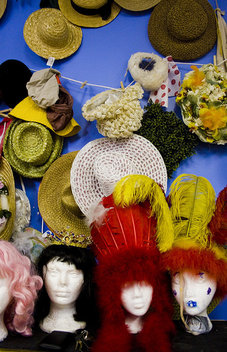 Hats hang above a row mannequin heads in the costume room of the MTA studio in Newport Beach.