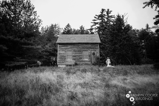 Haunted house wedding photo with abandoned building black and white - lesbian couple