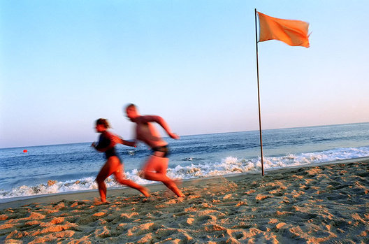 Ocean lifeguards go for a run on Main Beach in East Hampton, NY