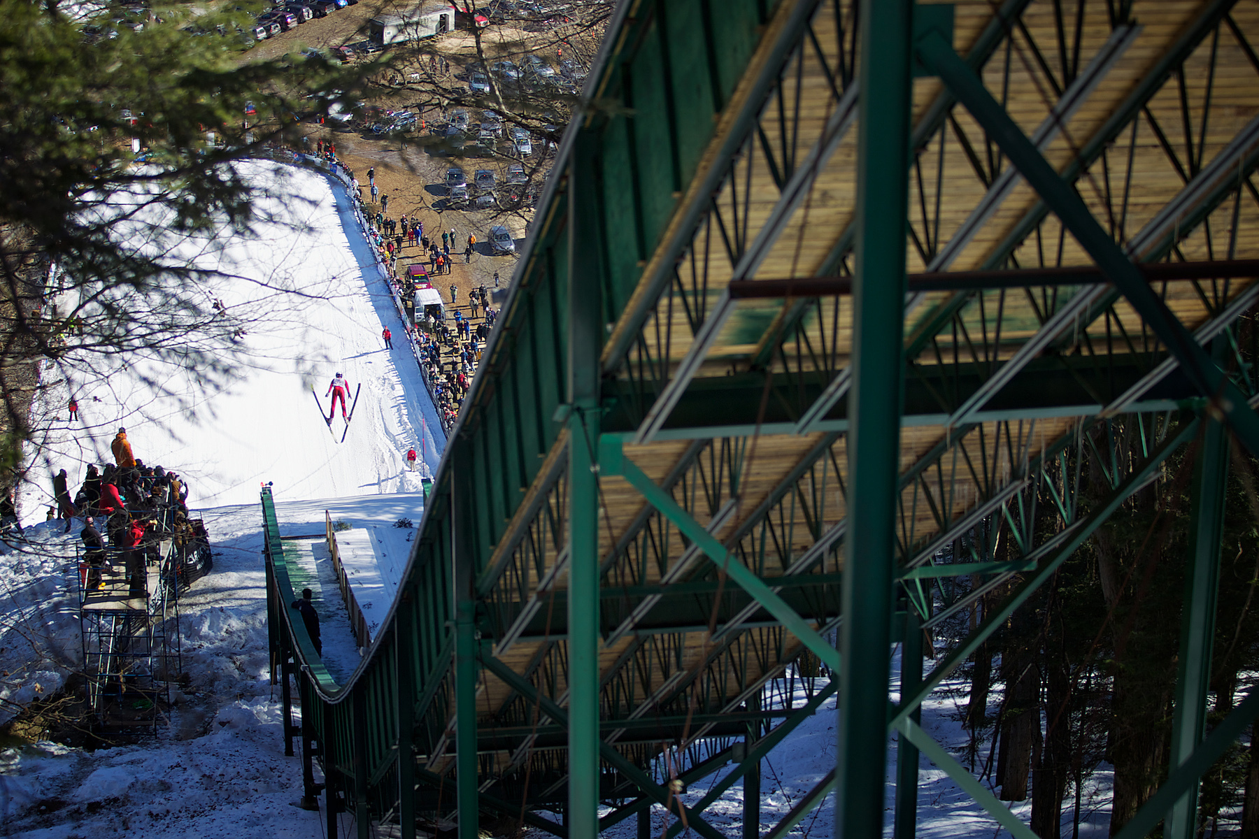 Athlete Somer Schrock takes flight early in the competition.  Somer was competing in the Junior II field and finished 13th with a score of 153.5.  Harris Hill Ski Jump, Brattleboro, Vermont. 2011