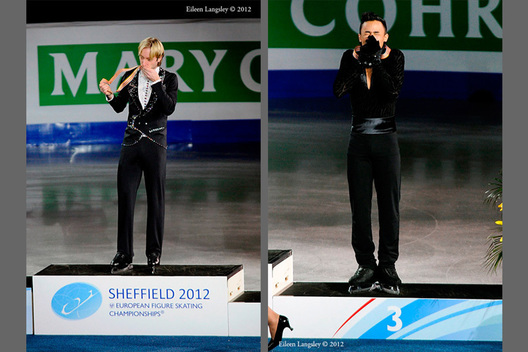 Evgeni Plushenko (Russia) left and Florent Amodio (France) right, celebrate winning the gold and bronze medals respectively at the 2012 European Figure Skating Championships at the Motorpoint Arena in Sheffield UK January 23rd to 29th.