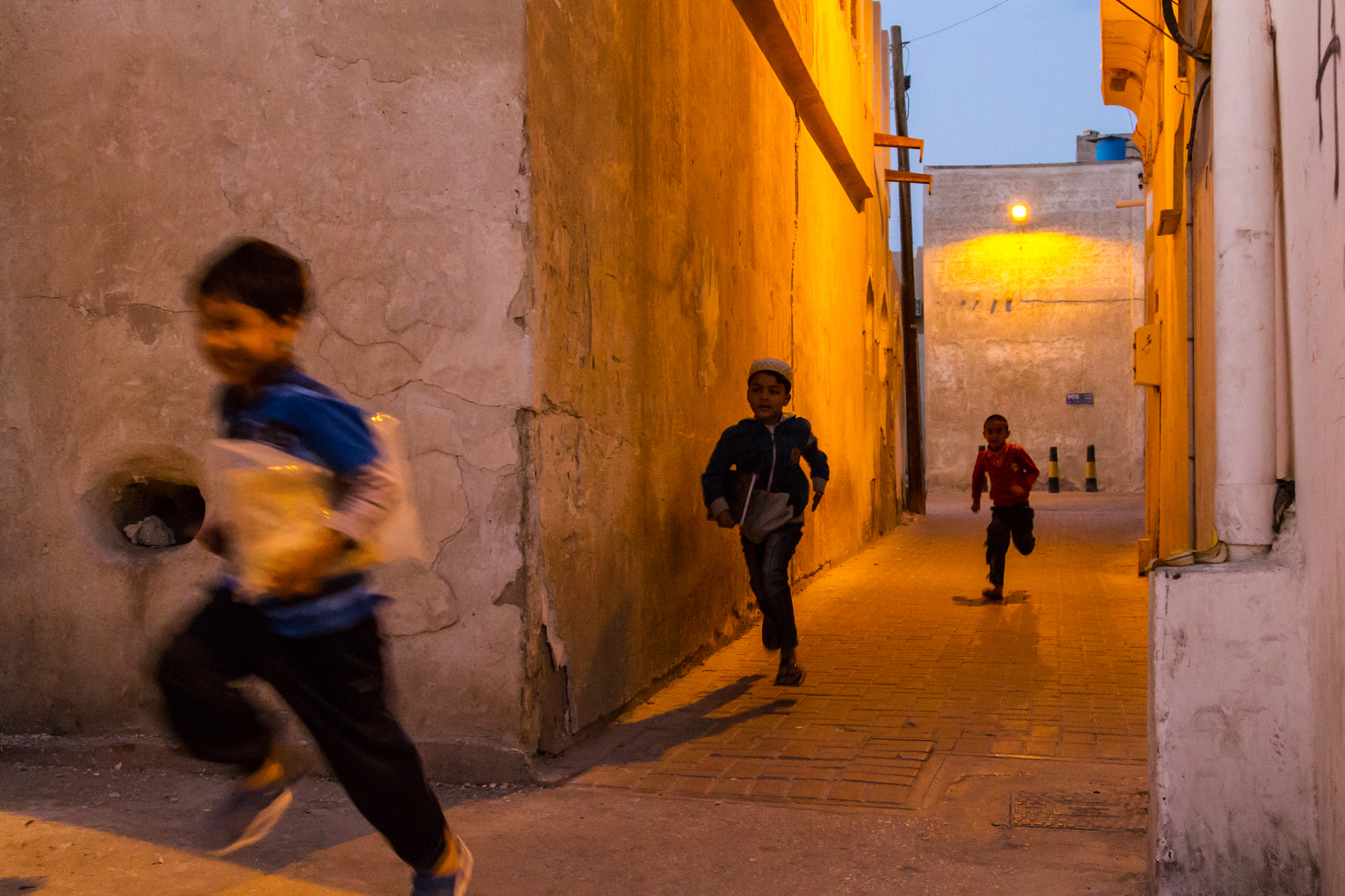 As the sundown Maghrib call to prayer filled the streets, the men entered the mosque as the boys chased each other down old Muharraq alleyways with Quran's tucked under their arms.