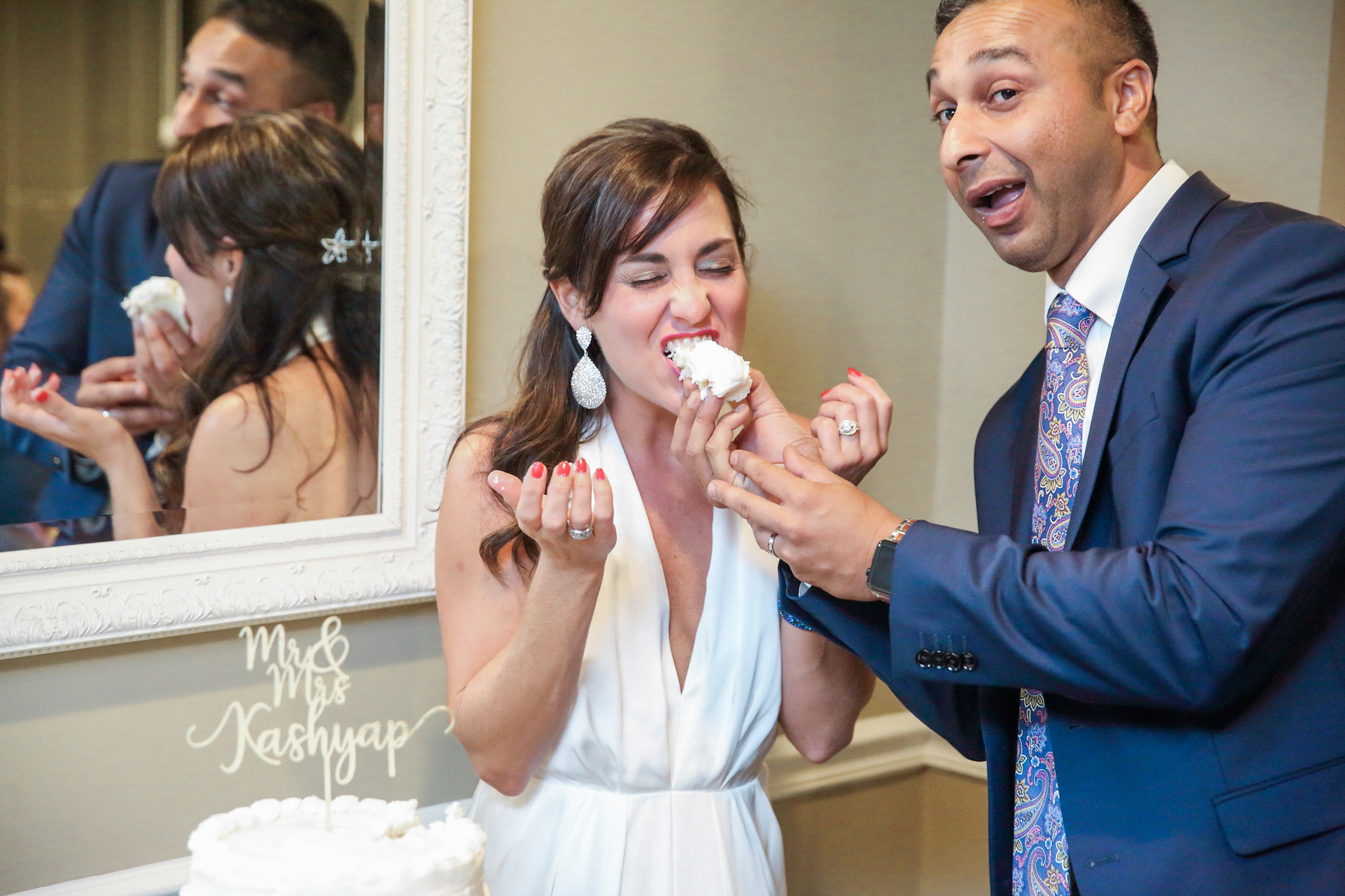 bride eats cake groom makes silly face