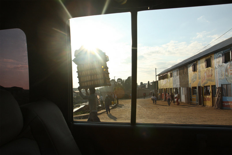 Objects are usually carried on the head.  Here a man carries a heavy load in the morning sunlight in Antananarivo.