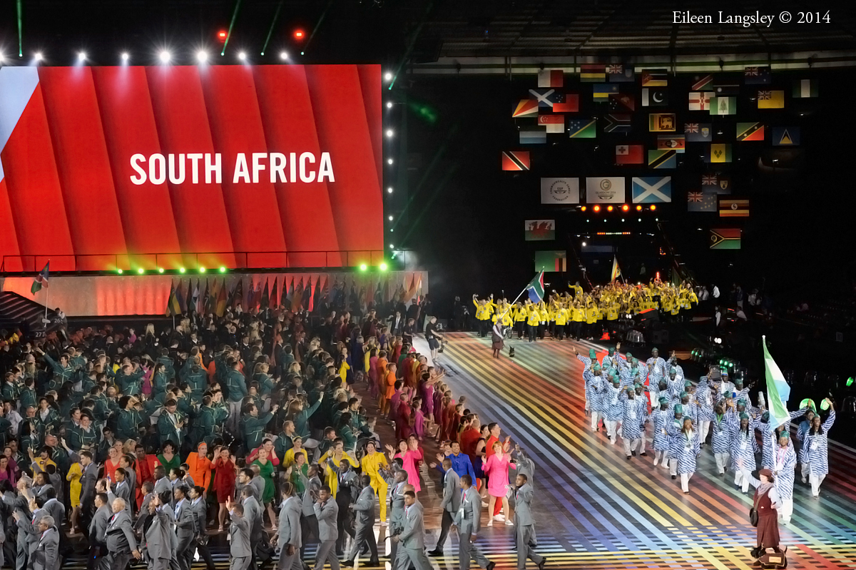 The team from South Africa enter the arena at the Opening Ceremony at the 2014 Glasgow Commonwealth Games .