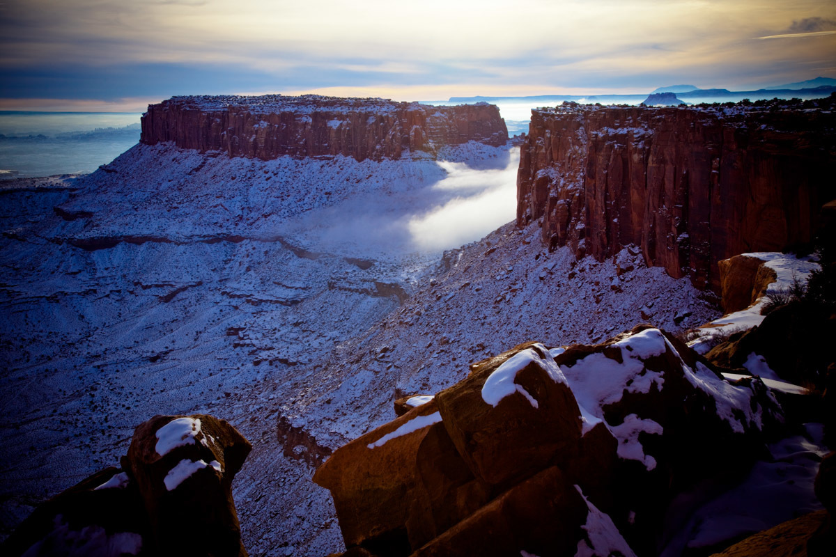 During a winter sunset, a deep mist floats through the canyons of Canyonlands National Park, Island in the Sky section, near Moab, Utah.
