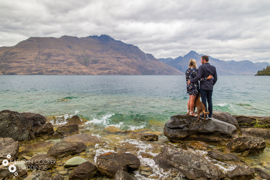 Queenstown NZ engagement photos of couple on lake