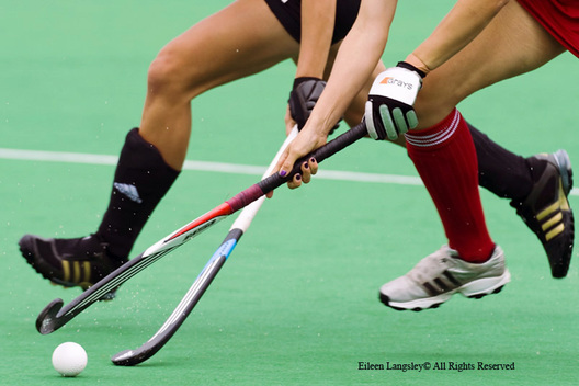 A cropped generic action image of an England and a German player chasing the ball during their match at the 2010 Women's World Cup Hockey Tournament in Nottingham