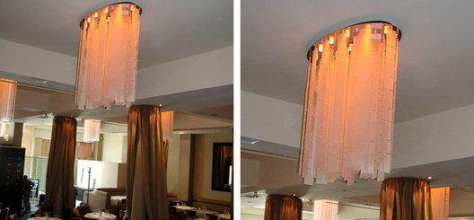 Frosted acrylic panel chain chandeliers with floating oval mirrored ceiling canopy