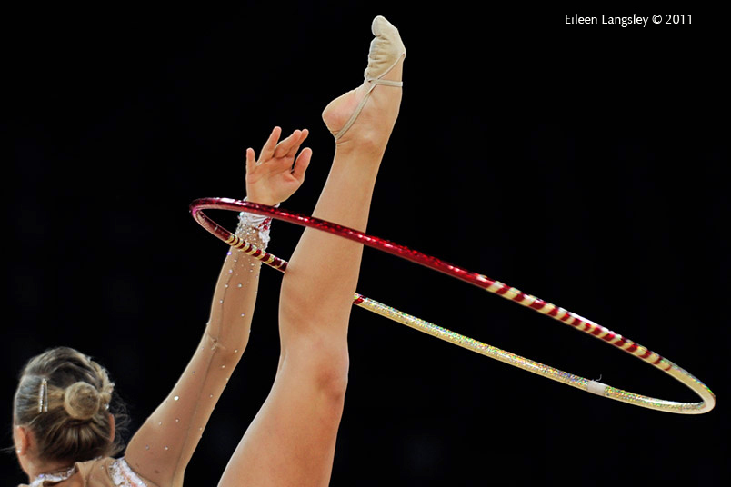 A cropped generic image of a gymnast competing with Hoop at the World Rhythmic Gymnastics Championships in Montpellier.